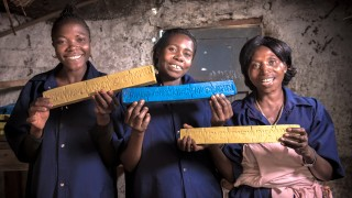 Our programme participants in the DRC holding up soap. Photo: Ryan Carter