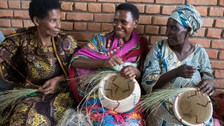 Participants making baskets in Rwanda.