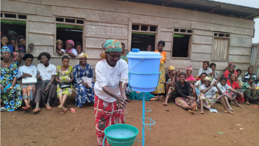 Women for Women International programme participants take part in a hand washing demonstration during Ebola epidemic in the Democratic Republic of Congo.