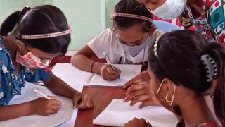 Adolescent girls attending a non-formal education class facilitated by a community teacher. Photo: Women for Women International