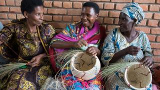 Participants making baskets in Rwanda.
