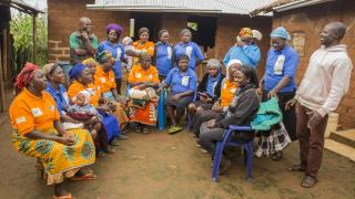 Change Agents (in orange t-shirts) gather for a meeting. Credit: Monilekan