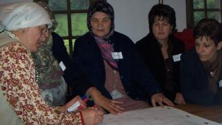 Women for Women International participants come together to learn and support one another.