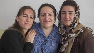 Kabira and Sheiran, two sisters who fled to the Kurdistan Region of Iraq, with Amina a Women for Women International Centre Manager. Without our staff on the ground, our work would not be possible. Photo: Alison Baskerville