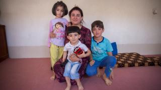 Kabira Habash, 40, with her two children and her nephew in her home
