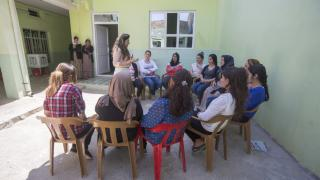 A group of programme participants in Iraq receive relaxation therapy. We have built strong partnerships with organisations who can offer psycho-social support, counselling, legal aid or shelter. Photo: Alison Baskerville