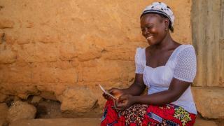 Faith Mathew reading letter