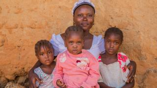 Faith with her three daughters. Photo credit: Monilekan