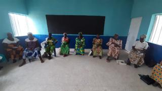Saratu and her group practice social distancing during a COVID-19 awareness session. Photo: Women for Women International.