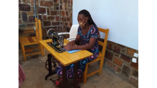 Jeanette, a graduate of the program in Rwanda, sewing masks