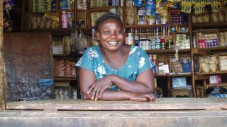 A Stronger Women, Stronger Nations programme graduate in her store. Photo: Women for Women International
