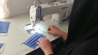 """Hasiba said, """"I was sewing traditional Kurdish clothes for my children when they wanted to go and play in a garden near my house. So, I decided to sew them masks."""" Photo: Women for Women International"""