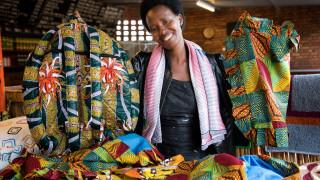 Women for Women International - Rwanda programme graduate, Immaculée, with her handicrafts. Photo credit: Hazel Thompson