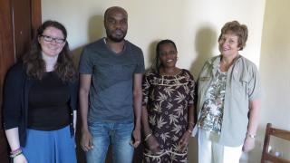 Anne Smith and Katie Hughes visit the DRC country office and are greeted by the staff
