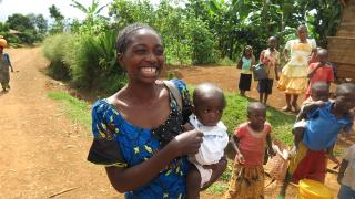 Anne met Yvone, pictured here with her young son Patrick, in her home in Cishugi. She shares how family planning was her favourite part of the programme. Photo: Women for Women International