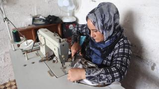 Shireen, Women for Women International-Iraq participant, runs a sewing business from her home. Many self-employed women and traders are being hit hard by the closure of markets. Photo: Alison Baskerville
