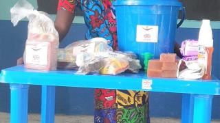 Saratu with her emergency package of hygiene items and food, provided during the COVID-19 lockdown with support from UK aid from the British people. Photo: Women for Women International