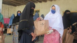 Distributing hygiene kits in Afghanistan during COVID-19. Photo: Women for Women International