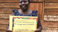 """Women for Women International programme participant from Democratic Republic of Congo receives her #MessageToMySister, """"You are not alone and forgotten"""". Photo: Women for Women International"""