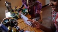 Women for Women International programme participant from Rwanda receives her #MessageToMySister. Photo: Aidan O'Neill