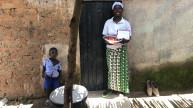A programme participant from Nigeria holding her #MessageToMySister postcard. Photo: Women for Women International