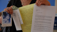 Programme participant with letters. Photo: Women for Women International