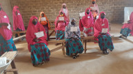The final cohort of women in Magama celebrate graduation from the 12-month programme in a socially-distanced ceremony. Photo: Women for Women International