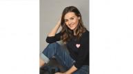 The #ShareYourHeart Knit worn by Women for Women International Ambassador, Niomi Smart.