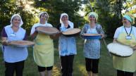 Programme graduates from Kosovo with a range of freshly baked breads. Photo: Simon Wheeler