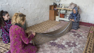 Shireen and her daughter-in-law preparing the fabric for the traditional Kurdish dress. Photo: Alison Baskerville.