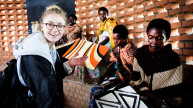 Sophie Turner meets women producing traditional Rwandan artwork. Photo: Hazel Thompson