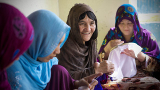 The Friends of Rights Association, Fatima, 60, with hand tumor, knitting