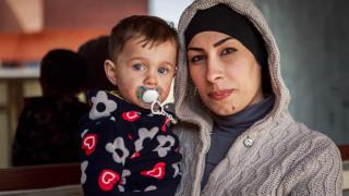 Eman, a Women for Women International programme participant and her son Benjamin. Photo: Emily Kinskey